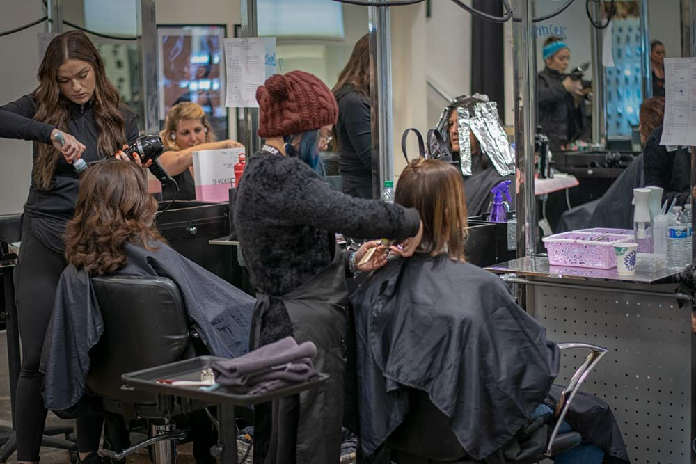 JD Academy student working on client hair in the salon